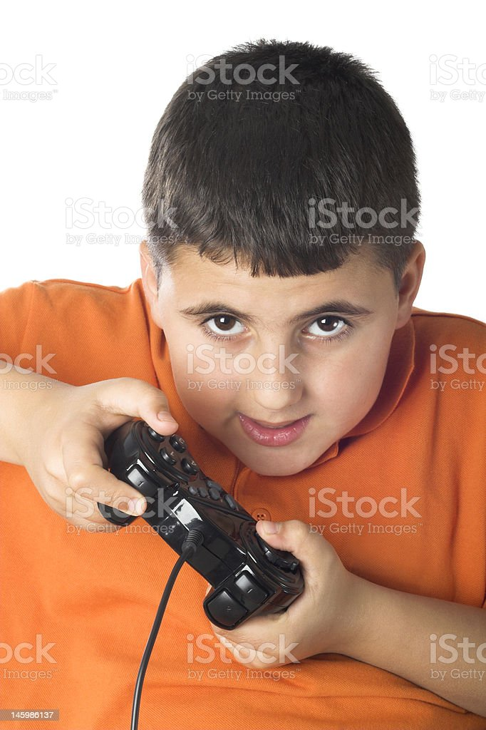 Young boy playing a video game with a controller stock photo