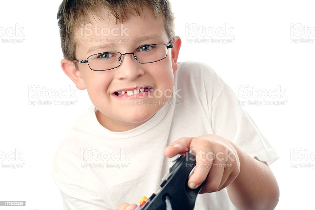 Young Boy Playing a Video Game with a Frustrated Expression stock photo
