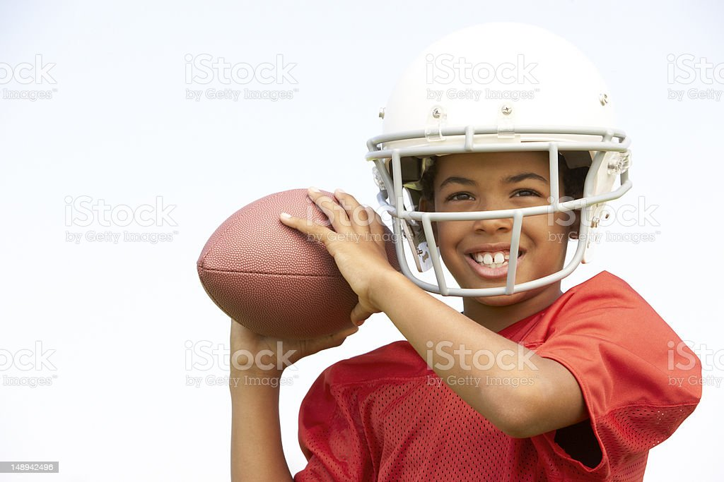 Young Boy Playing American Football stock photo