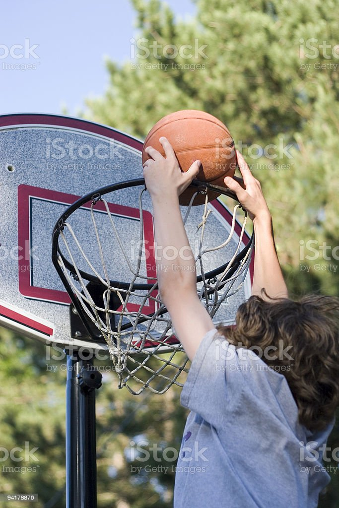 A young boy playing basketball royalty-free stock photo
