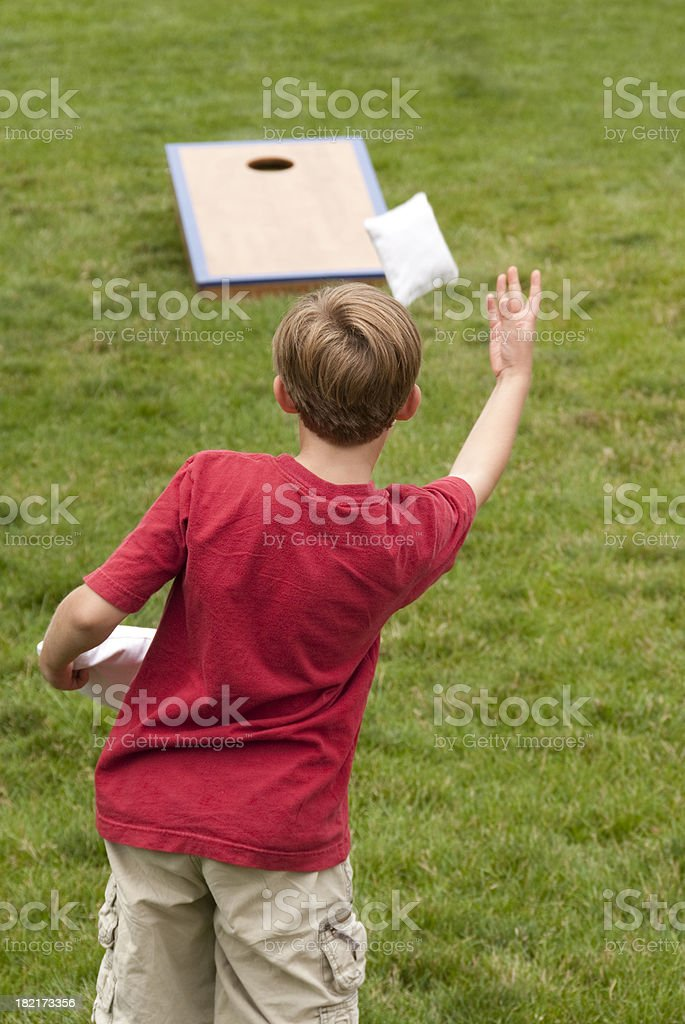 Young boy playing Cornhole stock photo