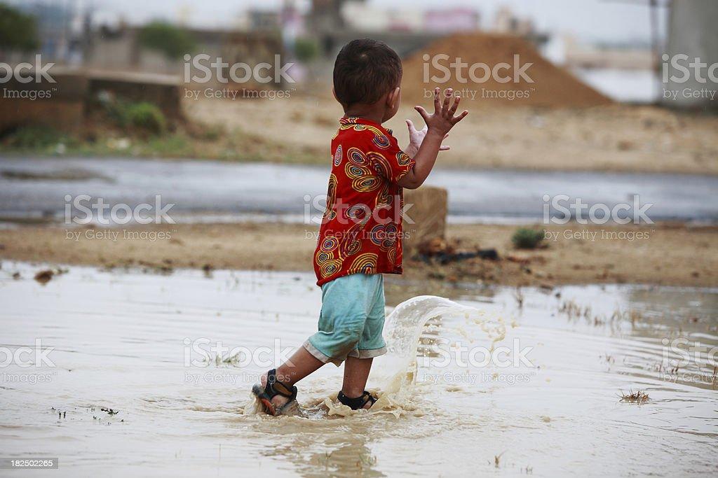 Young Boy Playing Freedom Rainwater Puddle Splashing royalty-free stock photo
