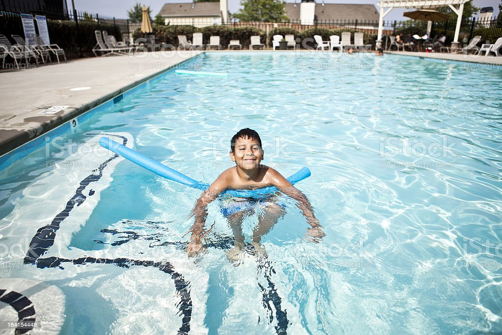young boy playing in the pool royalty-free stock photo