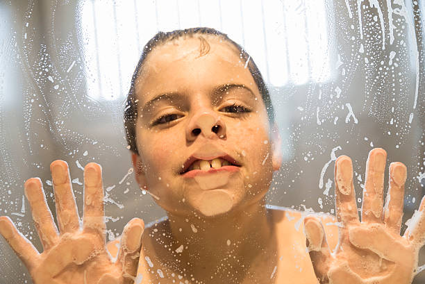 a boy naked peening in the bath