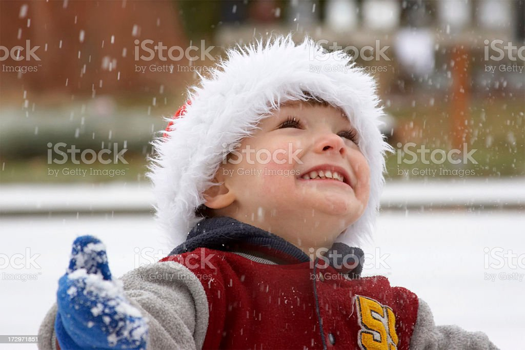 Young boy playing in the snow at Christmas royalty-free stock photo