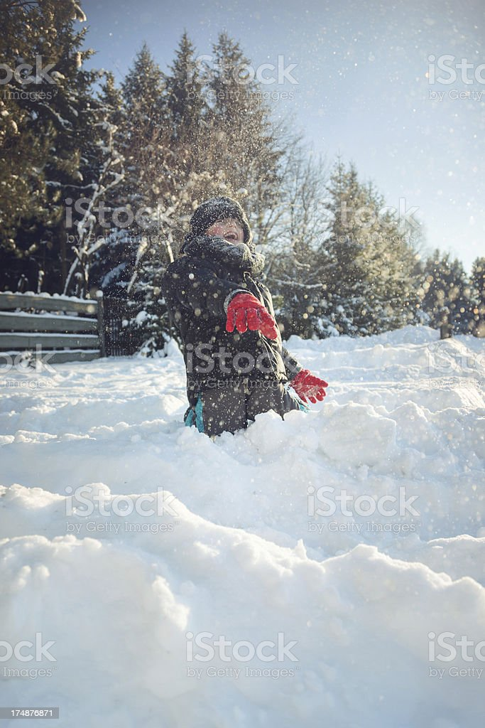 Young boy playing in the snow royalty-free stock photo