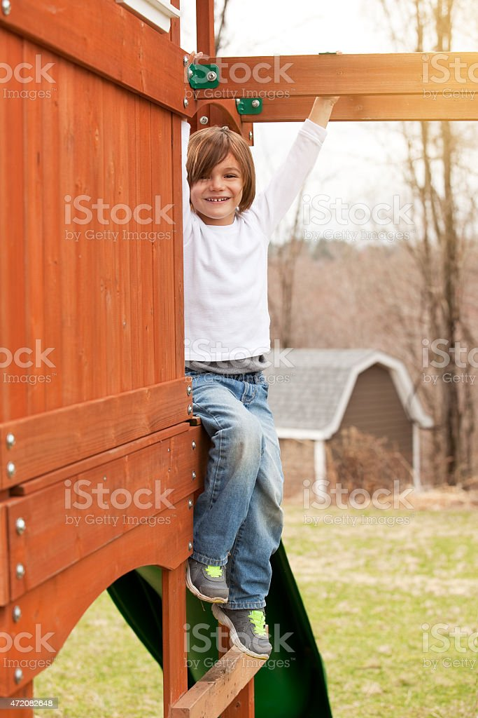 Young Boy Playing On Playset stock photo