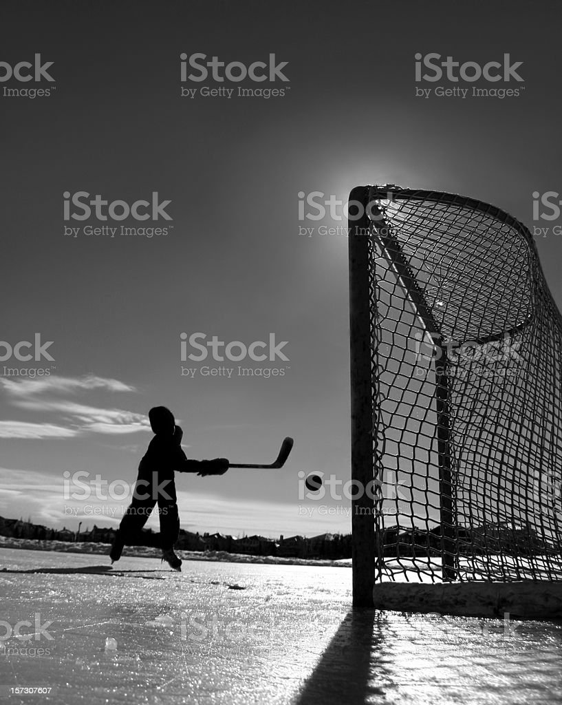 Young Boy Playing Outdoor ice Hockey royalty-free stock photo