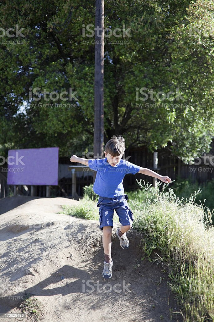 Young boy playing outside royalty-free stock photo