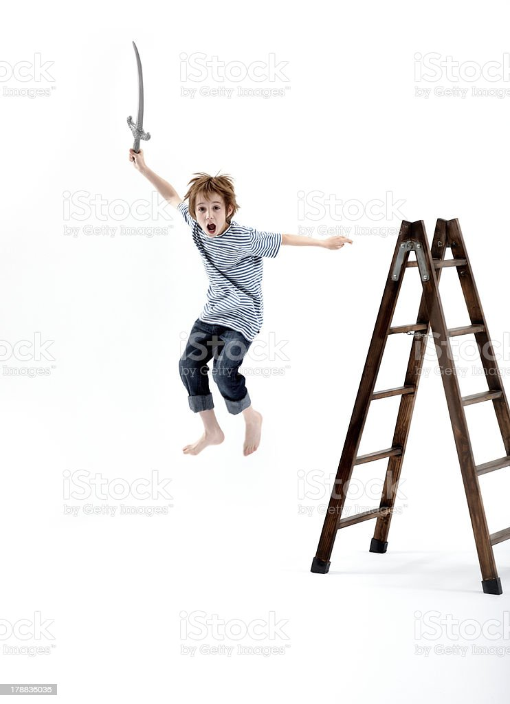 Young boy playing pirates royalty-free stock photo
