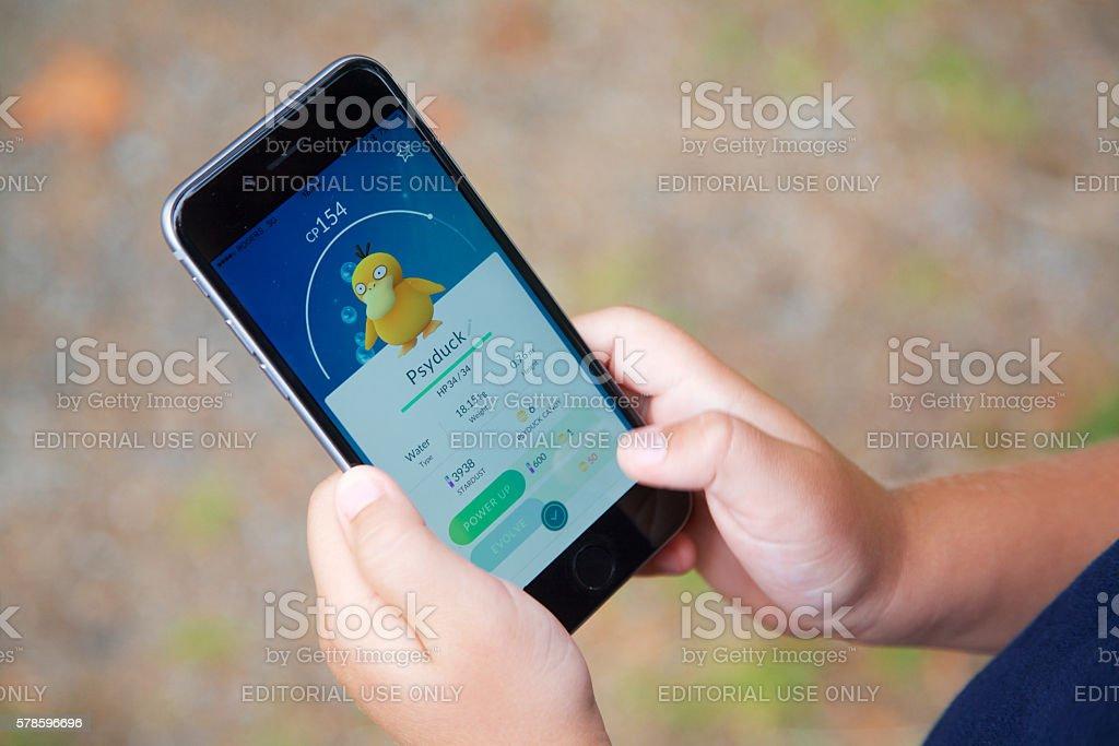 Young boy playing Pokemon Go stock photo