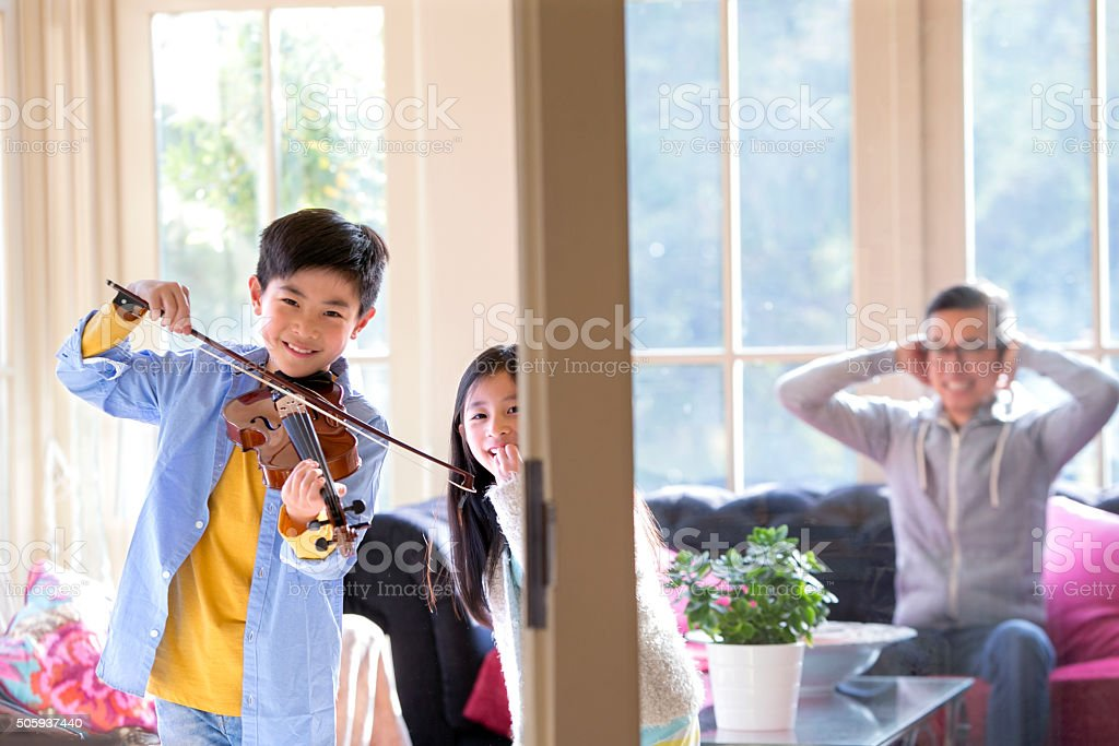 Young Boy Playing Violin stock photo