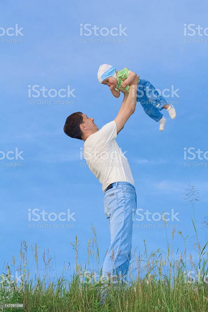 Young boy playing with father royalty-free stock photo