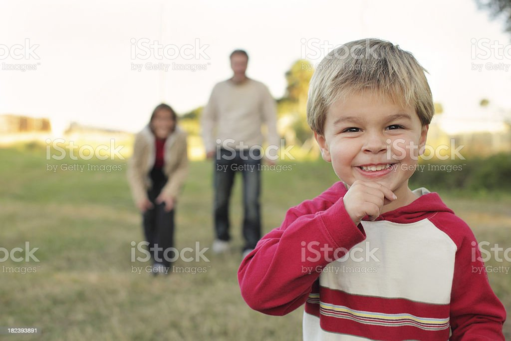 Young boy playing with parents royalty-free stock photo