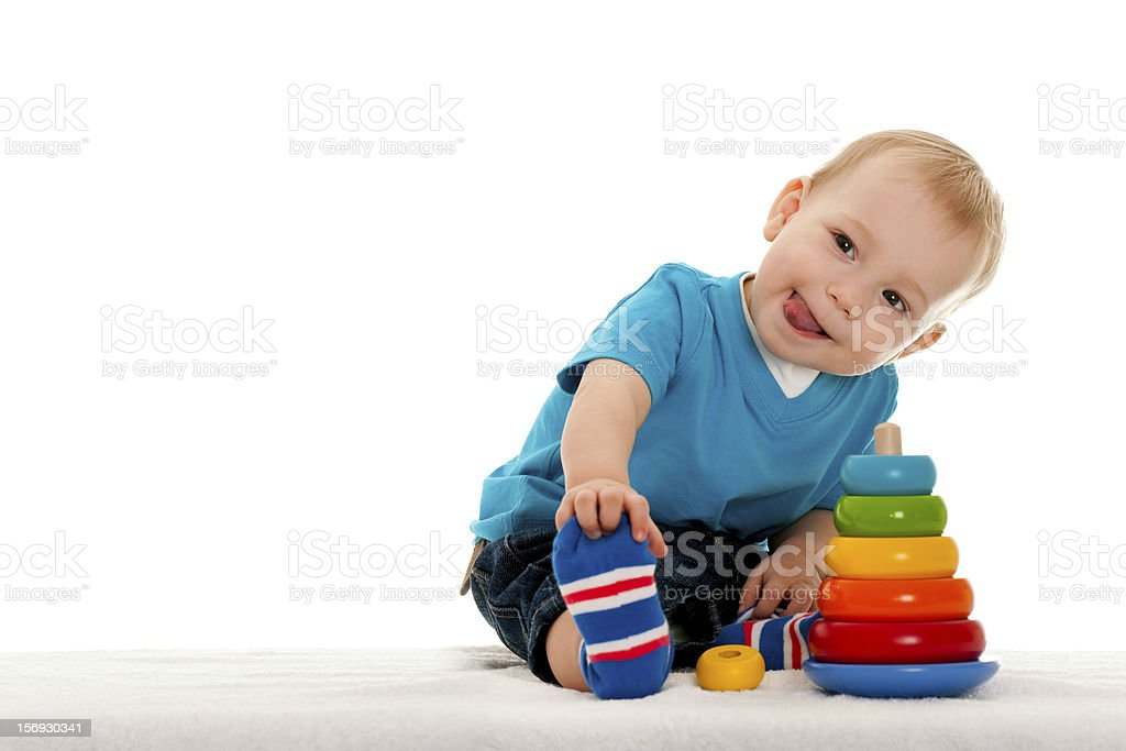 A young boy playing with the toys stock photo