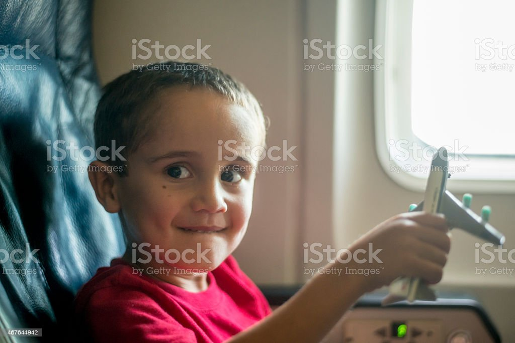 Young boy playing with toy airplane stock photo