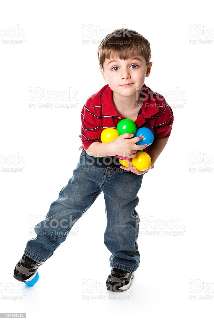 Young boy playing with toy balls royalty-free stock photo