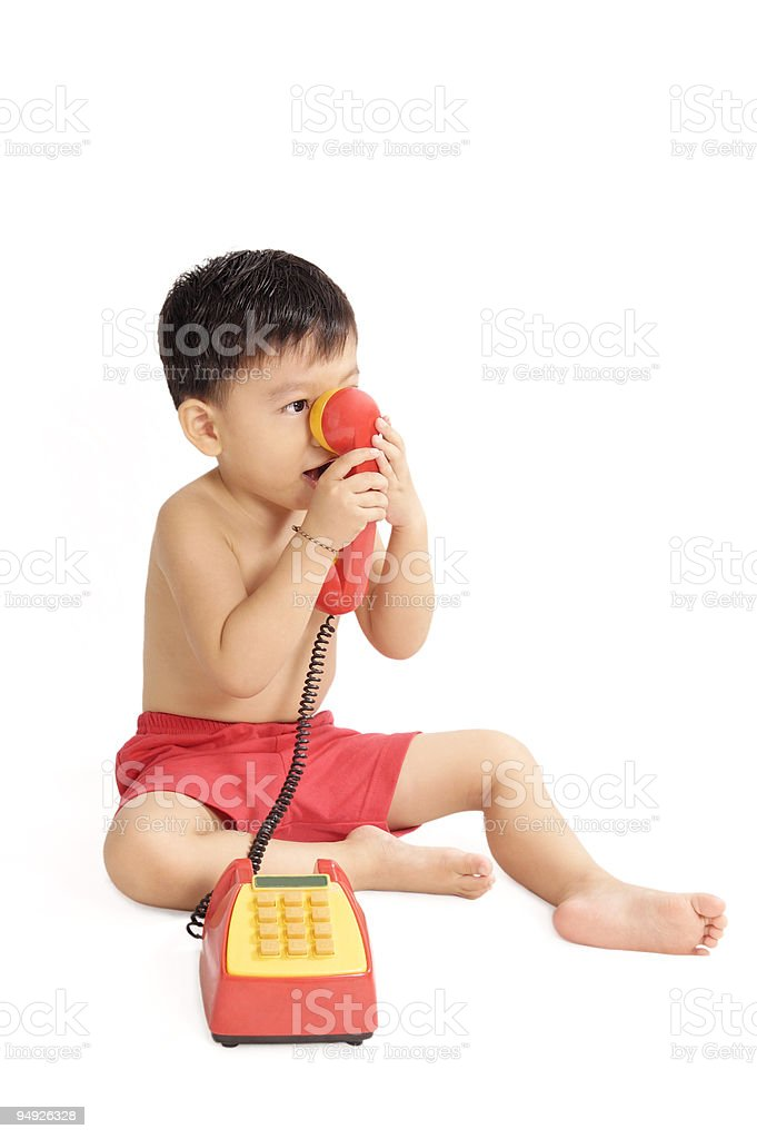 Young Boy Playing With Toy Phone stock photo