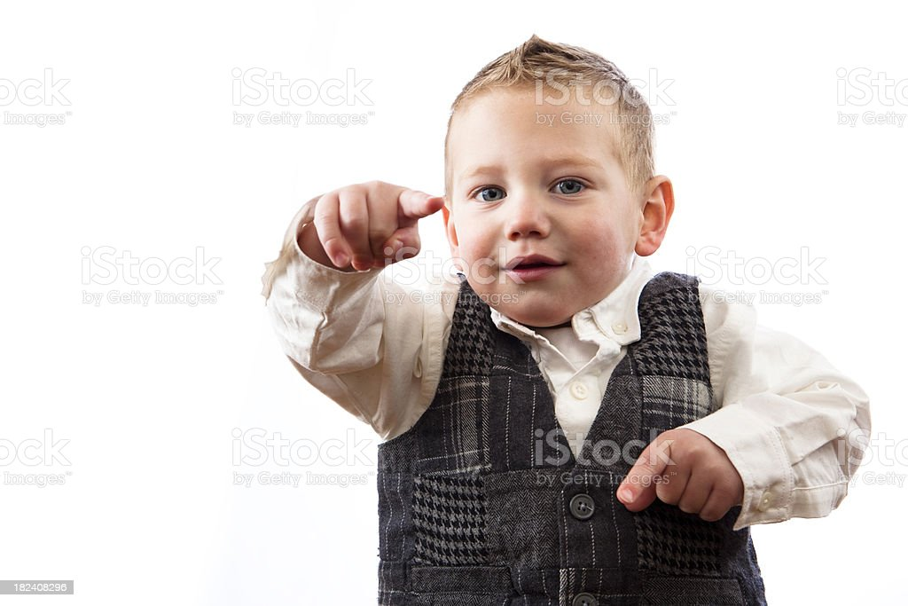 Young boy pointing with finger on white background stock photo