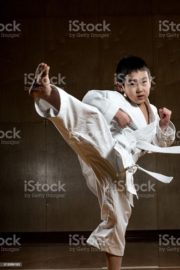 Young boy practicing karate stock photo