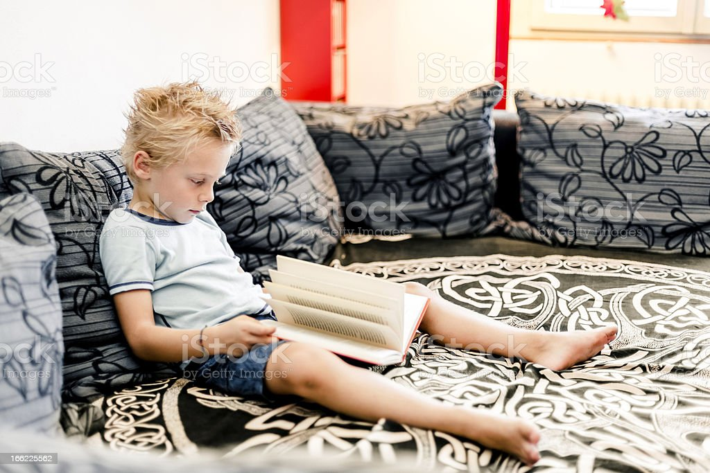 Young boy reading a book royalty-free stock photo