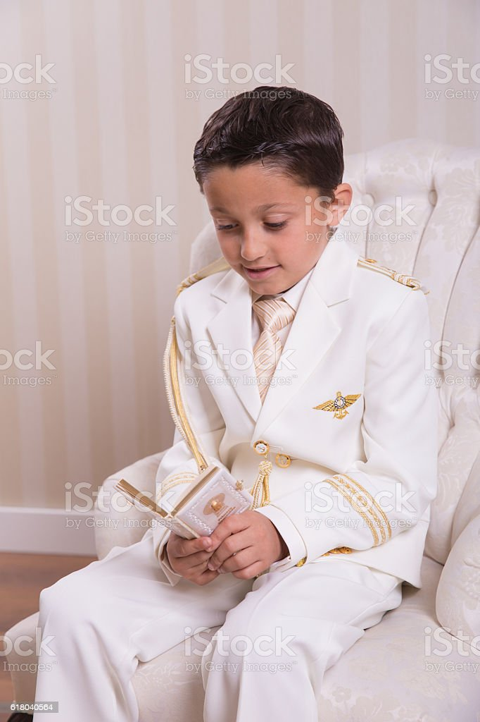 Young boy reading a prayer book stock photo