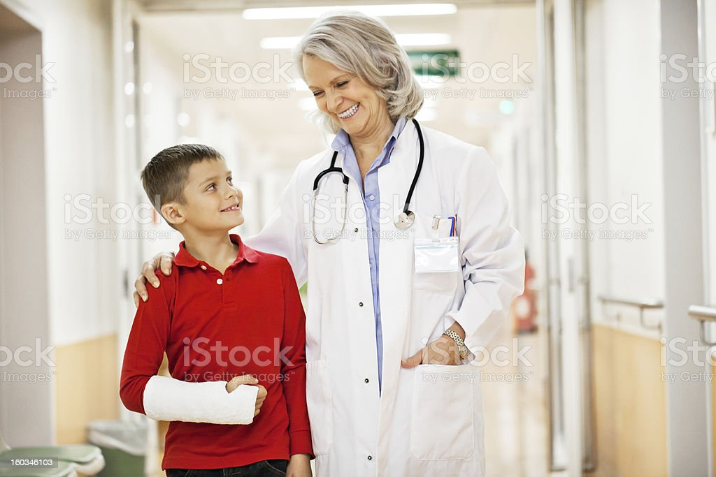 Young boy recovering from a broken arm stock photo
