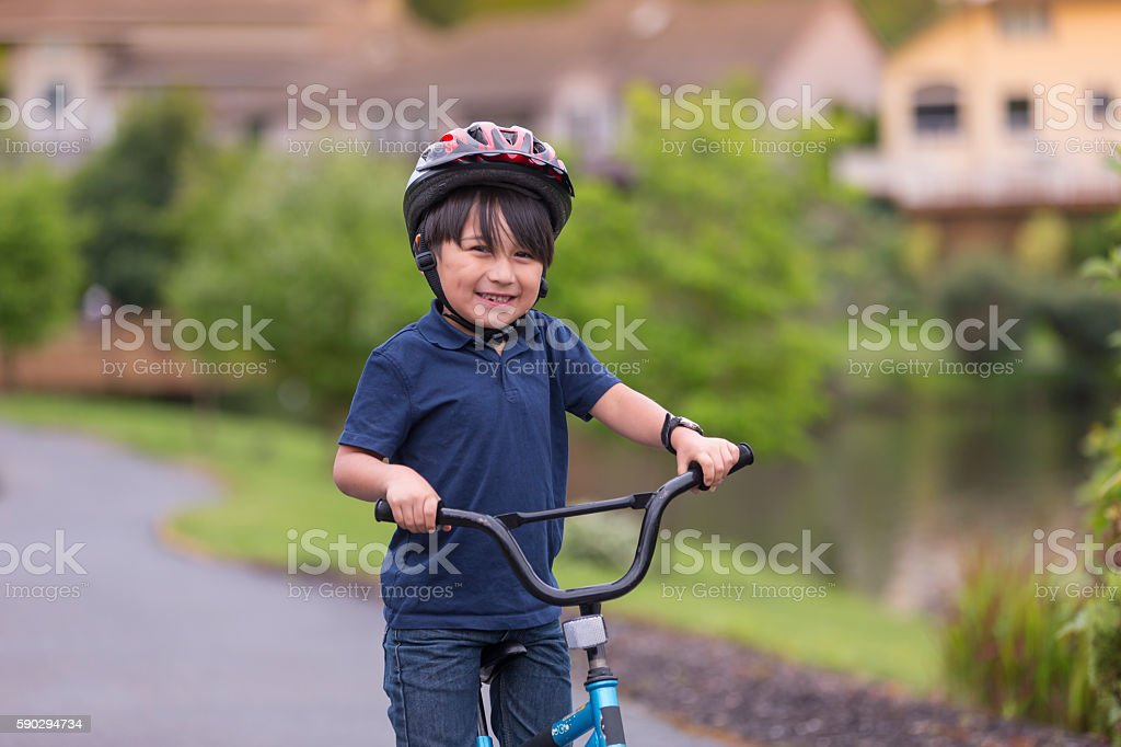 Young boy riding a bike stock photo