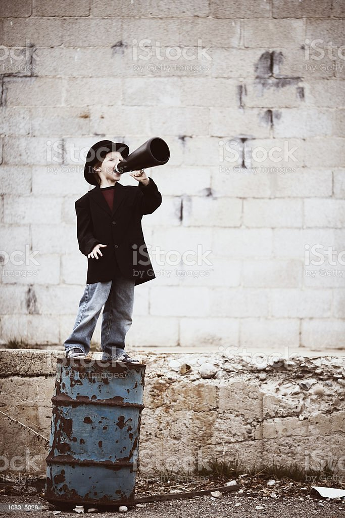 Young Boy Salesman Yells Through Megaphone royalty-free stock photo