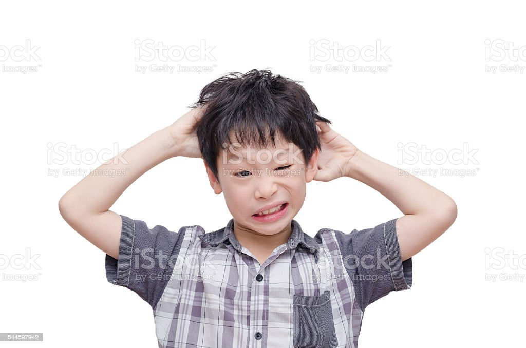 Young boy scratching his scalp stock photo
