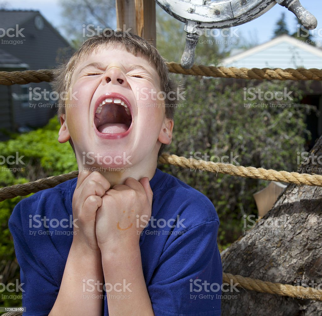 Young boy screaming royalty-free stock photo