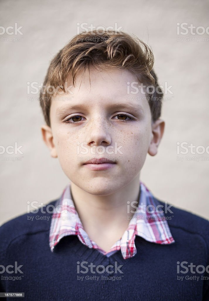 Young boy serious looking royalty-free stock photo