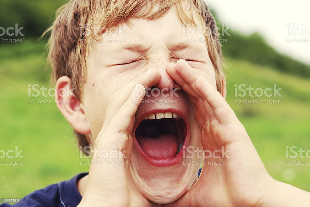 Young boy shouting out loud outdoors royalty-free stock photo