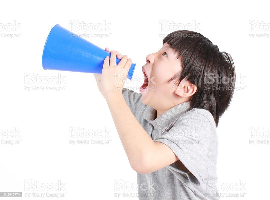 Young boy shouts into the megaphone Lizenzfreies stock-foto