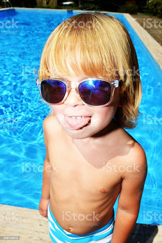 Young boy showing bigmouth stock photo
