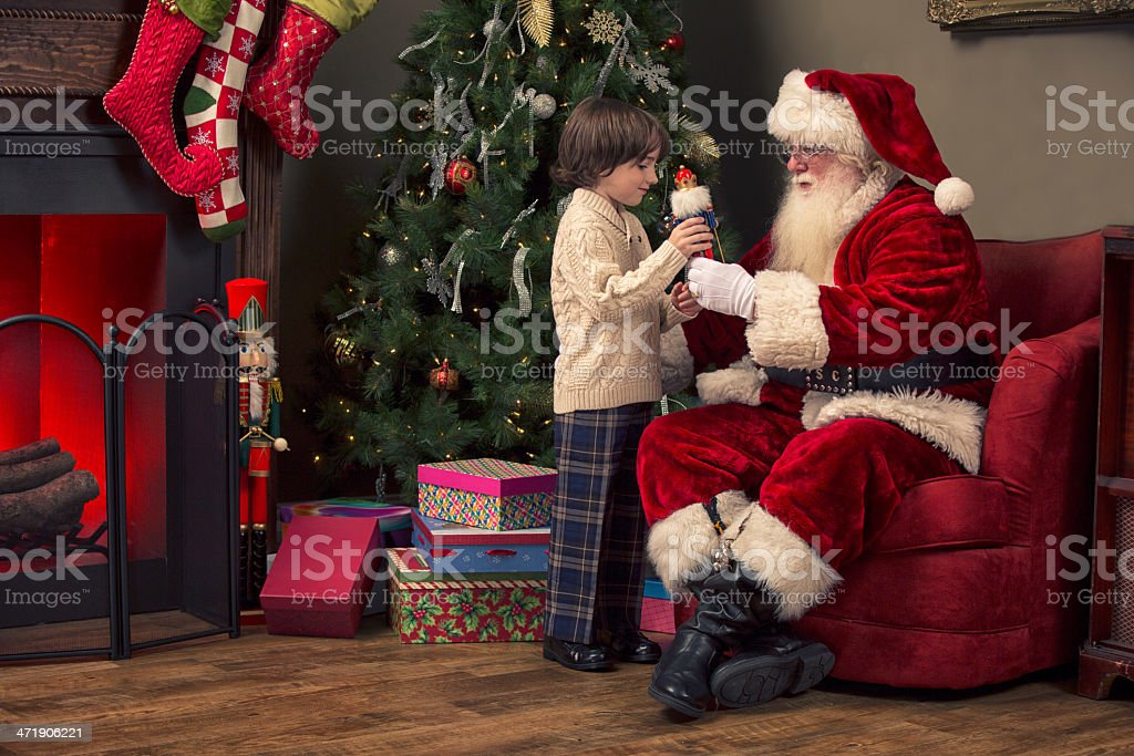 Young boy showing Real Santa Claus nutcracker. royalty-free stock photo