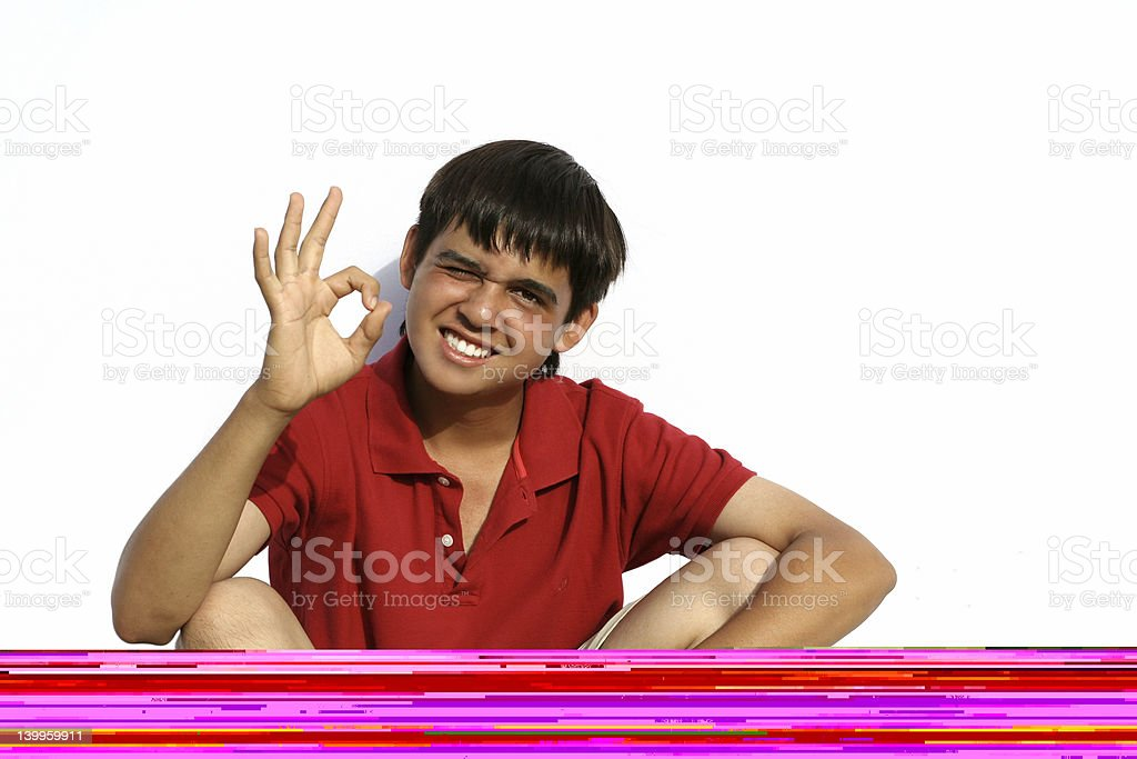 Young boy showing well done hand gesture stock photo