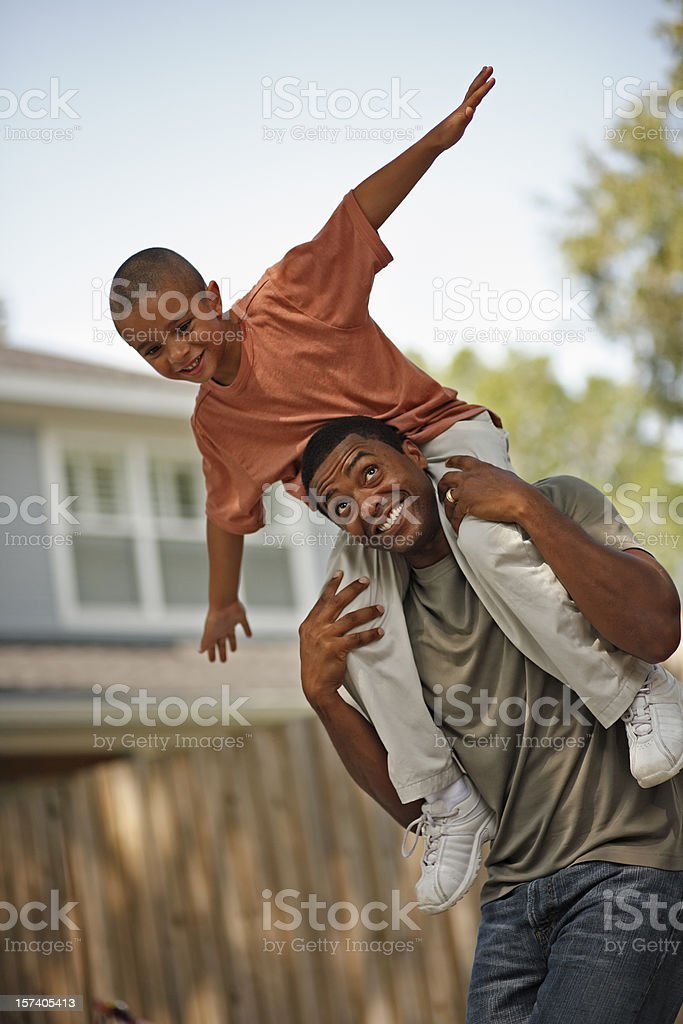 Young Boy Sitting on Dad's Shoulders royalty-free stock photo
