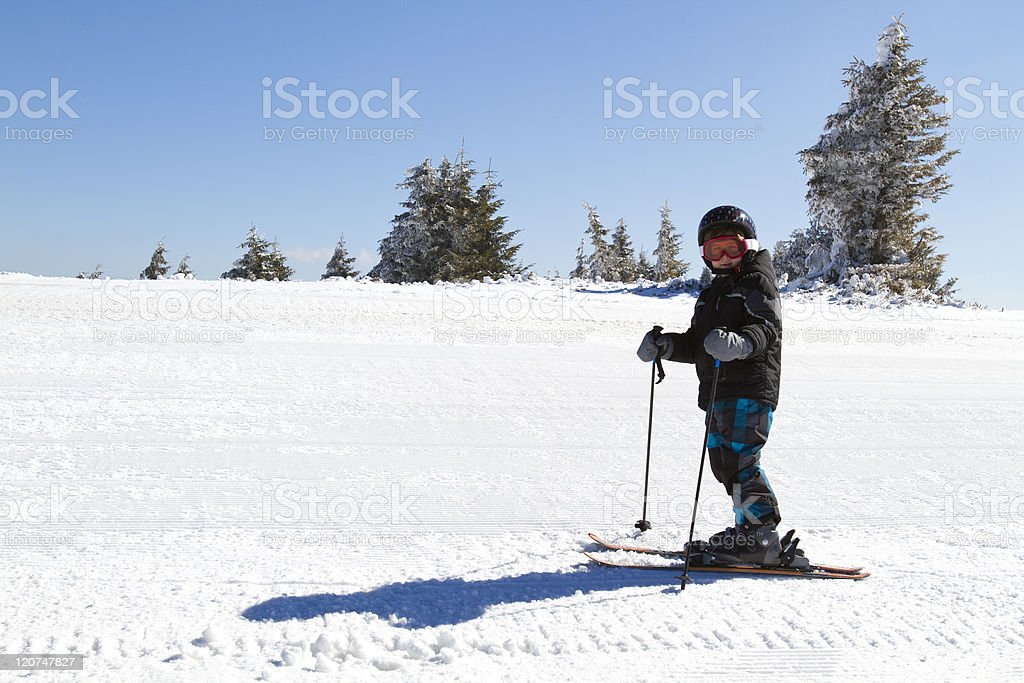 young boy skiing stock photo