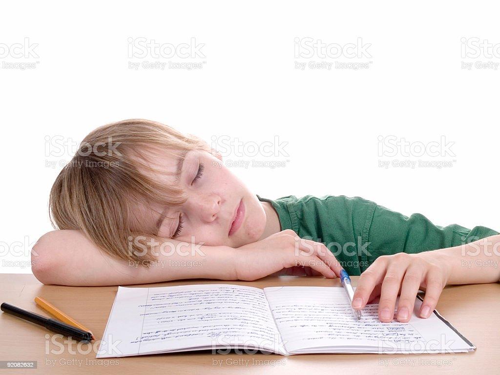 Young Boy Sleeping At School royalty-free stock photo