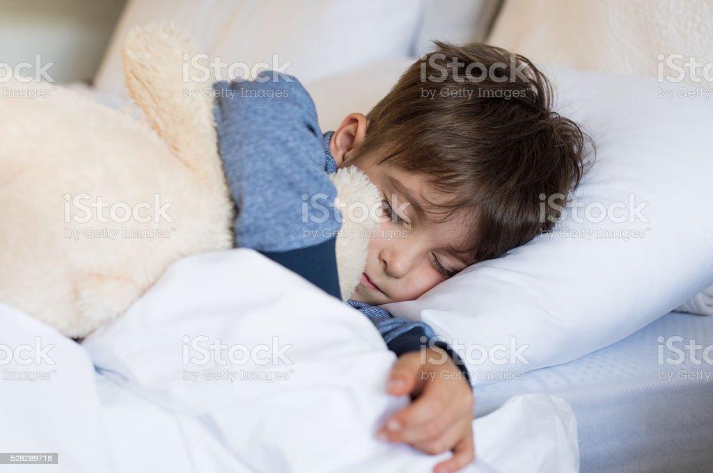 Young boy sleeping stock photo