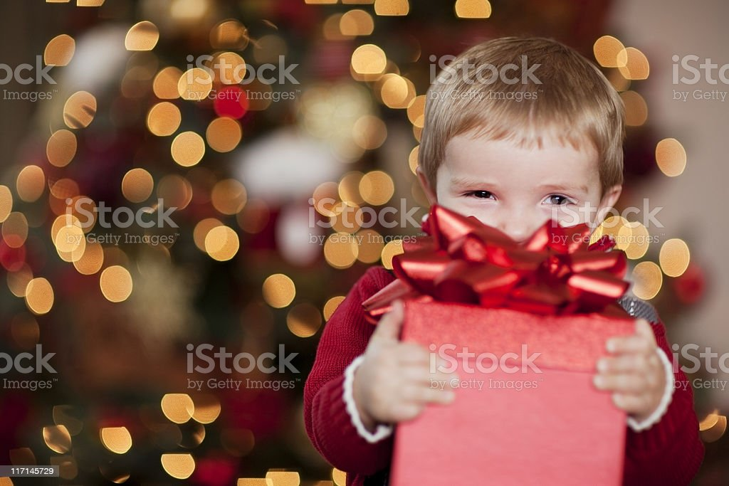 Young Boy Smiles with his Christmas Present royalty-free stock photo