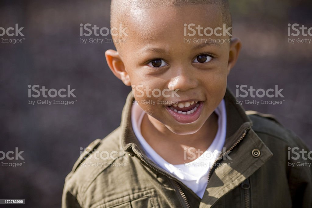 Young boy smiling for a picture for his parents royalty-free stock photo