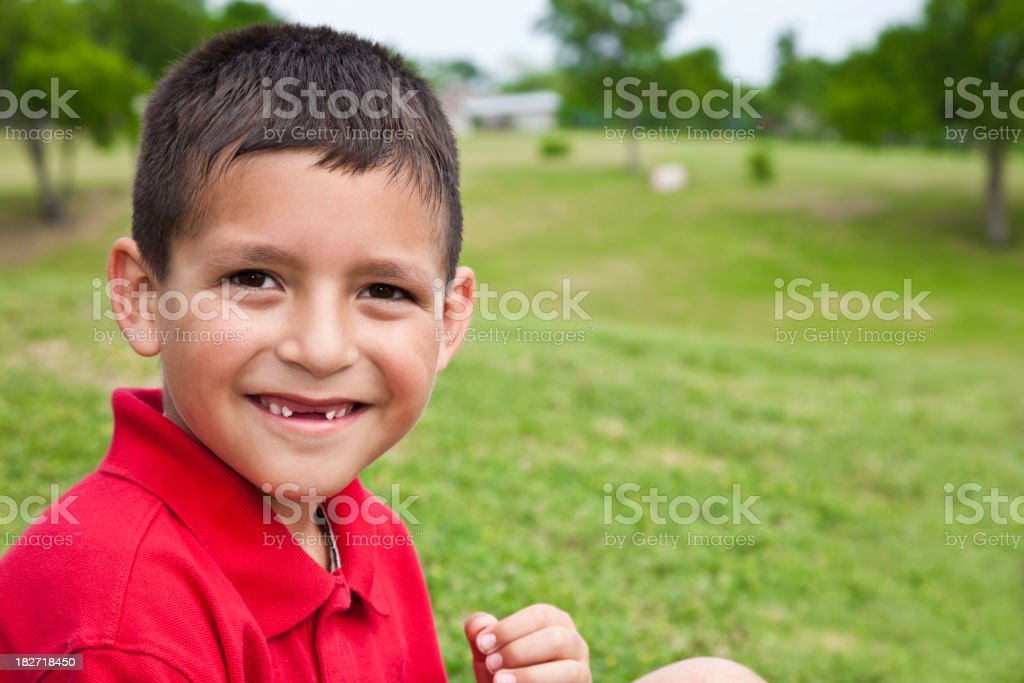 Young Boy Smiling in an open field, with copy space royalty-free stock photo