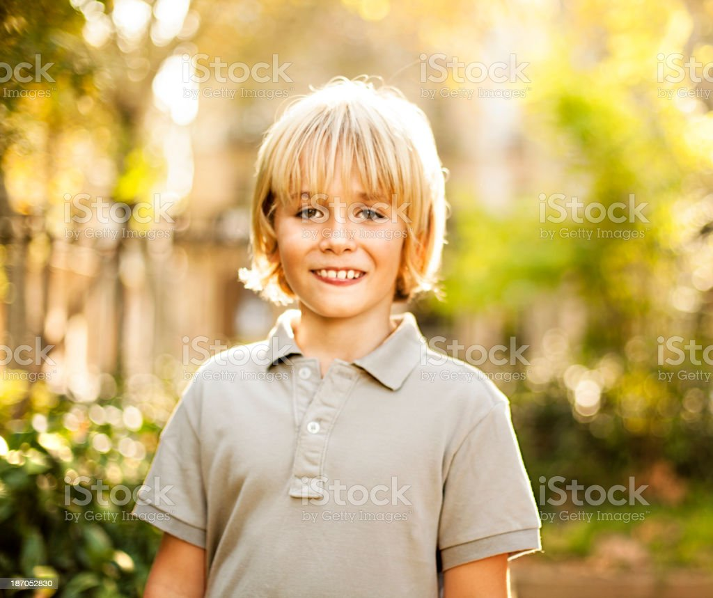 Young boy smiling in garden royalty-free stock photo