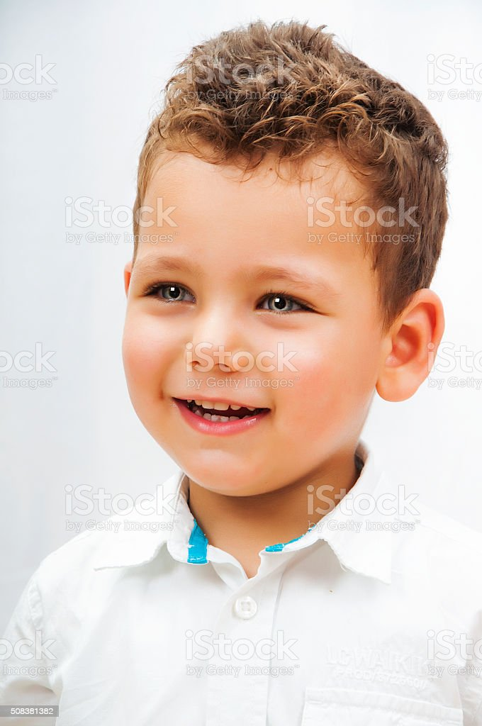 Young boy smiling on white stock photo