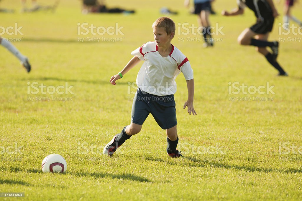 Young Boy Soccer Player in Action royalty-free stock photo