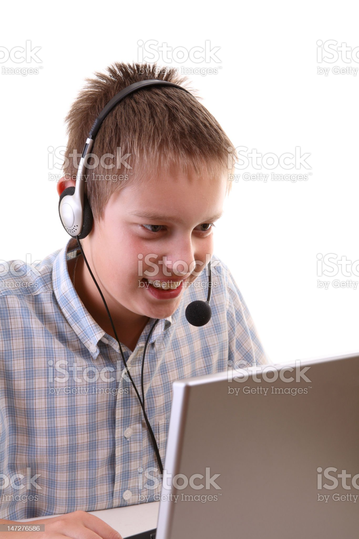 Young boy spending time with notebook royalty-free stock photo