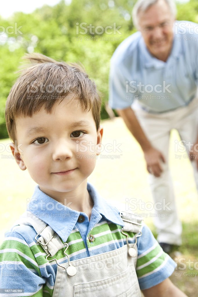 Young Boy Standing After Playing With Grandfather royalty-free stock photo