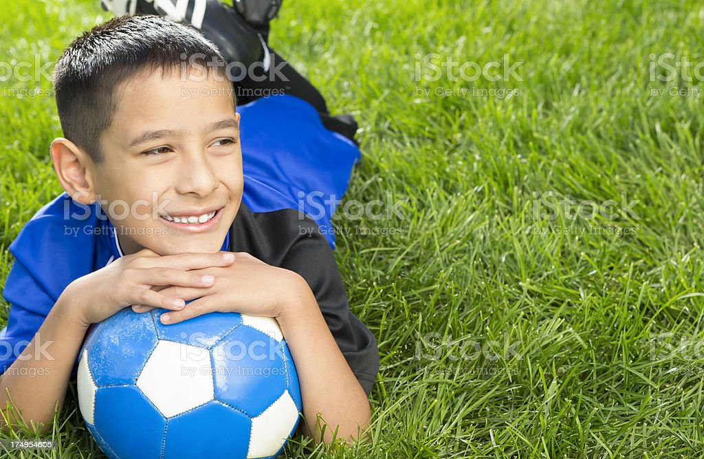 Young boy taking a break from soccer royalty-free stock photo